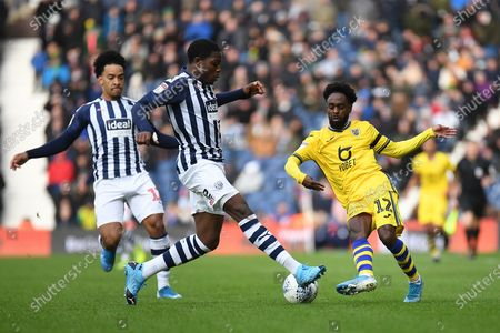 Swansea City midfielder Nathan Dyer (12) looks to release the ball  under pressure from West Bromwich Albion defender Nathan Ferguson (36) during the EFL Sky Bet Championship match between West Bromwich Albion and Swansea City at The Hawthorns, West Bromwich
