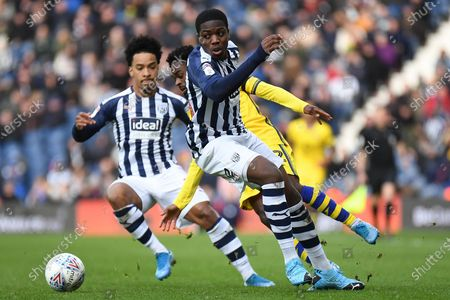 West Bromwich Albion defender Nathan Ferguson (36) fouls Swansea City midfielder Nathan Dyer (12) during the EFL Sky Bet Championship match between West Bromwich Albion and Swansea City at The Hawthorns, West Bromwich