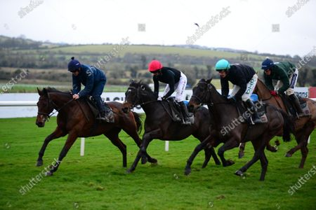 PUNCHESTOWN. KEMBOY and Patrick Mullins (centre, red cap) working after racing for trainer Willie Mullins with CHACUN POUR SOI and Ruby Walsh (left) and Gold Cup winner AL BOUM PHOTO with Paul Townend (right).