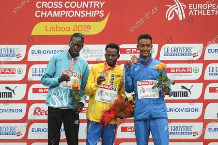 Stock Photo of Robel Fsiha of Sweden (C), Aras Kaya of Turkey (L) and Yemaneberhan Crippa of Italy (R), Gold, Silver and Bronze medalists respectively in the cross country senior men's race at the European Cross Country Championships, held in Parque da Bela Vista in Lisbon, Portugal, 08 December 2019.