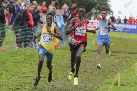 Robel Fsiha of Sweden (L), Aras Kaya of Turkey (C) and Yemaneberhan Crippa of Italy (R), Gold, Silver and Bronze medalists respectively, in action during the cross country senior men's race at the European Cross Country Championships, held in Parque da Bela Vista in Lisbon, Portugal, 08 December 2019.