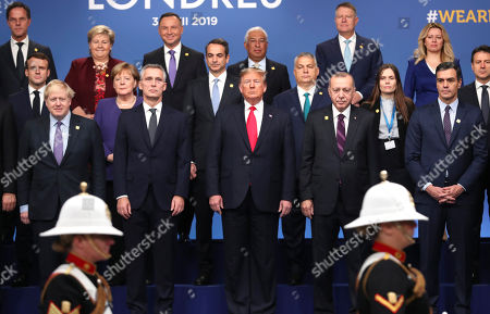 From front row left, British Prime Minister Boris Johnson, NATO Secretary General Jens Stoltenberg, U.S. President Donald Trump, Turkish President Recep Tayyip Erdogan and Spanish Prime Minister Pedro Sanchez attend a ceremony event during a NATO leaders meeting at The Grove hotel and resort in Watford, Hertfordshire, England. Three years into the Trump presidency, America's new place in the world is coming into focus, with influence waning from NATO meeting rooms to the Middle East to the capital cities of key allies. And in many ways, that's just fine with the White House