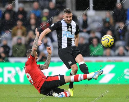 Danny Ings of Southampton flies in with a challenge on Paul Dummett of Newcastle United