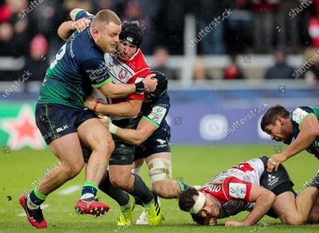 Gloucester vs Connacht. Gloucester's Ben Morgan is tackled by Finlay Bealham and Joe Maksymiw of Connacht