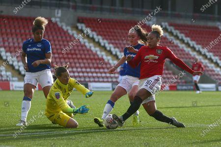 Tinja-Riikka Korpela of Everton saves at the feet of Lauren James of Manchester United