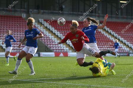 Stock Photo of Tinja-Riikka Korpela of Everton saves at the feet of Lauren James of Manchester United
