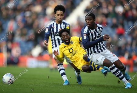 Nathan Dyer of Swansea City is tackled by Nathan Ferguson of West Bromwich Albion.