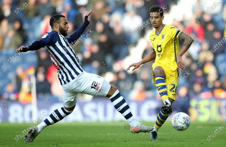 Kyle Naughton of Swansea City is tackled by Matt Phillips of West Bromwich Albion.
