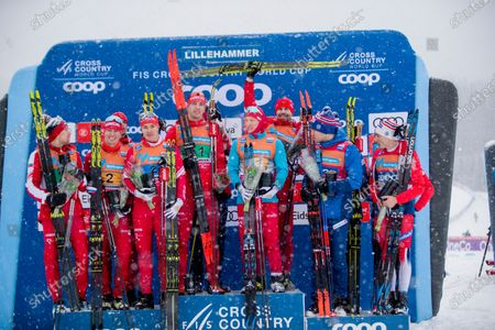 From left in second place Russia's first team with Andrey Larkov, Ilia Semikov, Denis Spitsov and Andrey Melnichenko, the winners Russia's second team with Ivan Yakimushkin, Evgeniy Belov, Ilia Poroshkin and Sergey Ustiugov and third place Norway's first team with Pål Golberg, Holund Hans Christer, Sjur Rø Find Hågen Krogh after the men's World Cup cross-country 4x7.5 km relay at the FIS Cross Country World Cup in Lillehammer, Norway, 08 December 2019.