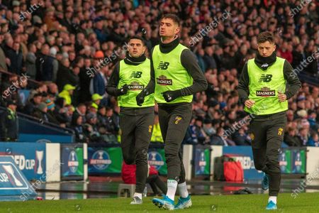 Stock Image of Nir Bitton of Celtic FC leads out the substitute's  Tom Rogic of Celtic FC & Mikey Johnston of Celtic FC during the Betfred Scottish League Cup Final match between Rangers and Celtic at Hampden Park, Glasgow