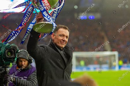 Celtic Legend Chris Sutton hold the Betfred Scottish League Cup aloft in front of the Celtic fans ahead of the Betfred Scottish League Cup Final match between Rangers and Celtic at Hampden Park, Glasgow