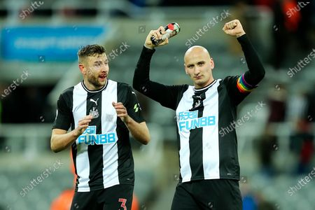 Jonjo Shelvey (#8) of Newcastle United celebrates Newcastle United's 2-1 victory as a bloodied Paul Dummett (#3) of Newcastle United looks on following the Premier League match between Newcastle United and Southampton at St. James's Park, Newcastle