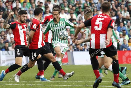 Real Betis midfielder Sergio Canales (C) vies for the ball with Athletic Bilbao's Unani Nunez (L), Dani Garcia (2-L) and Yeray Alvarez (R) during their LaLiga game at Benito Villamarin Stadium in Seville, southern Spain, 08 December 2019.