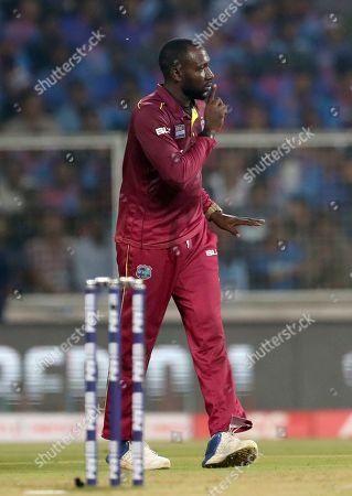 Stock Image of West Indies' Kesrick Williams celebrates the dismissal of India's Ravindra Jadeja during the second Twenty20 international cricket match between India and West Indies in Thiruvanathapuram, India