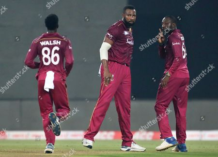 West Indies' Kesrick Williams, right, gestures to his teammate to celebrate the dismissal of India's captain Virat Kohli during the second Twenty20 international cricket match between India and West Indies in Thiruvanathapuram, India
