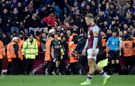 Leicester's Jamie Vardy, center, reacts after scoring his side's fourth goal during the English Premier League soccer match between Aston Villa and Leicester City at Villa Park in Birmingham, England