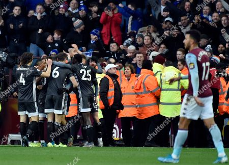 Leicester's Jamie Vardy celebrates with teammates after scoring his side's fourth goal during the English Premier League soccer match between Aston Villa and Leicester City at Villa Park in Birmingham, England