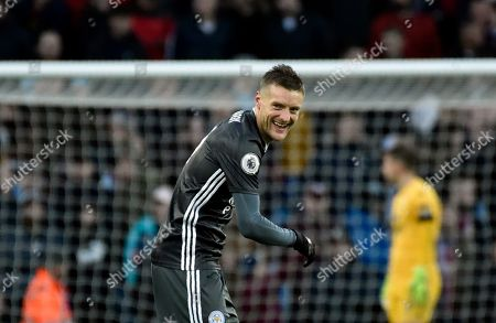 Leicester's Jamie Vardy smiles after scoring his side's fourth goal during the English Premier League soccer match between Aston Villa and Leicester City at Villa Park in Birmingham, England