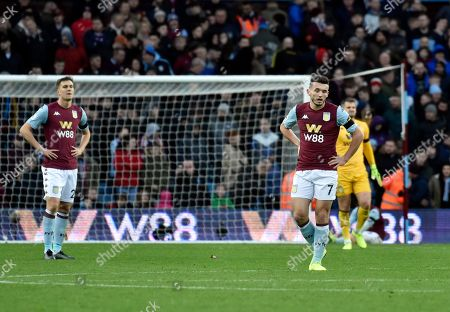 Aston Villa players react after Leicester's Jamie Vardy scoring his side's fourth goal during the English Premier League soccer match between Aston Villa and Leicester City at Villa Park in Birmingham, England