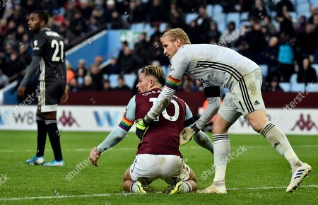 Stock Picture of Leicester's goalkeeper Kasper Schmeichel, right, helps Aston Villa's Jack Grealish up off the ground during the English Premier League soccer match between Aston Villa and Leicester City at Villa Park in Birmingham, England