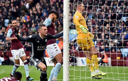 Leicester's Jamie Vardy celebrates after scoring his side's opening goal during the English Premier League soccer match between Aston Villa and Leicester City at Villa Park in Birmingham, England