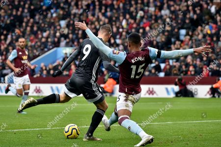 Leicester's Jamie Vardy, left, scores his side's opening goal during the English Premier League soccer match between Aston Villa and Leicester City at Villa Park in Birmingham, England