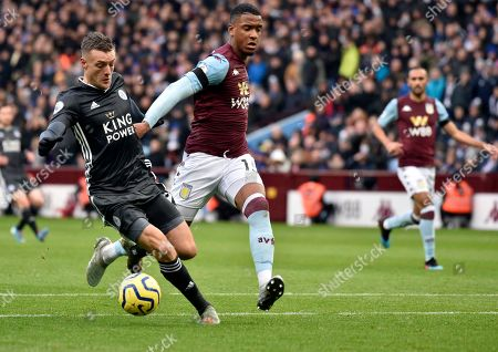 Leicester's Jamie Vardy, left, duels for the ball with Aston Villa's Ezri Konsa during the English Premier League soccer match between Aston Villa and Leicester City at Villa Park in Birmingham, England
