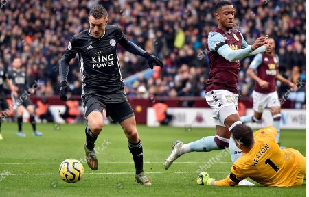 Aston Villa's goalkeeper Tom Heaton, right, tries to block a shot from Leicester's Jamie Vardy, left, during the English Premier League soccer match between Aston Villa and Leicester City at Villa Park in Birmingham, England
