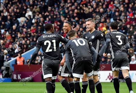 Leicester's Jamie Vardy celebrates with teammates after scoring his side's opening goal during the English Premier League soccer match between Aston Villa and Leicester City at Villa Park in Birmingham, England