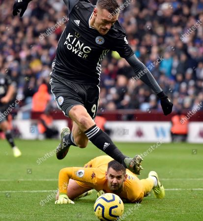 Aston Villa's goalkeeper Tom Heaton tries to block a shot from Leicester's Jamie Vardy, top, during the English Premier League soccer match between Aston Villa and Leicester City at Villa Park in Birmingham, England