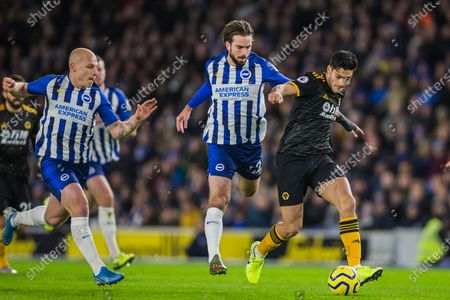 Aaron Mooy (Brighton), Davy Propper (Brighton) & Raul Jimenez (Wolverhampton Wanderers) during the Premier League match between Brighton and Hove Albion and Wolverhampton Wanderers at the American Express Community Stadium, Brighton and Hove