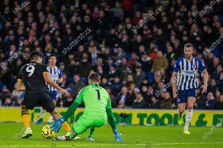 Mathew Ryan (GK) (Brighton) comes to get the ball from Raul Jimenez (Wolverhampton Wanderers) during the Premier League match between Brighton and Hove Albion and Wolverhampton Wanderers at the American Express Community Stadium, Brighton and Hove