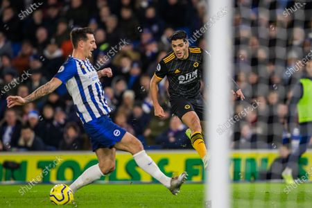 Raul Jimenez (Wolverhampton Wanderers) gets the ball away as Lewis Dunk (Capt) (Brighton) comes up to the goal during the Premier League match between Brighton and Hove Albion and Wolverhampton Wanderers at the American Express Community Stadium, Brighton and Hove