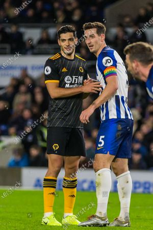 Raul Jimenez (Wolverhampton Wanderers) & Lewis Dunk (Capt) (Brighton) waiting for the ball from the corner kick taken by Joao Moutinho (Wolverhampton Wanderers) during the Premier League match between Brighton and Hove Albion and Wolverhampton Wanderers at the American Express Community Stadium, Brighton and Hove