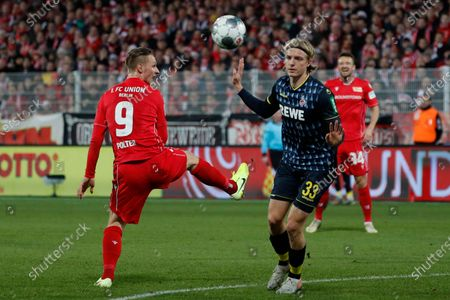 Union's Sebastian Polter (L) in action against Cologne's Sebastiaan Bornauw (R) during the  German Bundesliga soccer match between Union Berlin and 1. FC Koeln in Berlin, Germany, 08 December 2019.