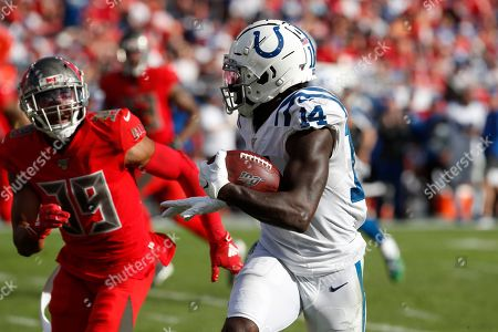 Indianapolis Colts wide receiver Zach Pascal (14) runs past Tampa Bay Buccaneers strong safety Andrew Adams (39) during the second half of an NFL football game, in Tampa, Fla