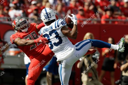 Indianapolis Colts wide receiver Marcus Johnson (83) beats Tampa Bay Buccaneers strong safety Andrew Adams (39) for a toouchdown during the first half of an NFL football game, in Tampa, Fla
