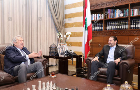 In this photo released by the Lebanese Government, Lebanon's outgoing Prime Minister Saad Hariri, right, meets with Samir Khatib, the head of a major contracting and construction and once considered a favorite candidate for the post of Prime Minister, in Beirut, Lebanon