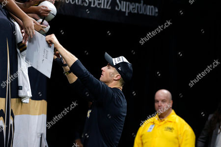 New Orleans Saints quarterback Drew Brees signs autographs for fans before an NFL football game against the San Francisco 49ers in New Orleans