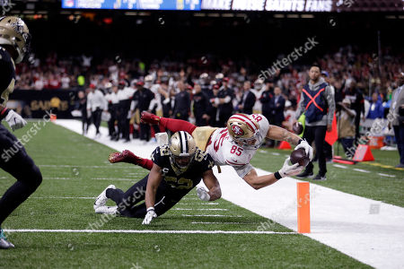 San Francisco 49ers tight end George Kittle (85) dives to the pylon for a touchdown against New Orleans Saints linebacker Craig Robertson (52) in the second half an NFL football game in New Orleans
