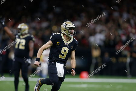 New Orleans Saints quarterback Drew Brees (9) reacts after throwing a touchdown pass in the first half an NFL football game against the San Francisco 49ers in New Orleans