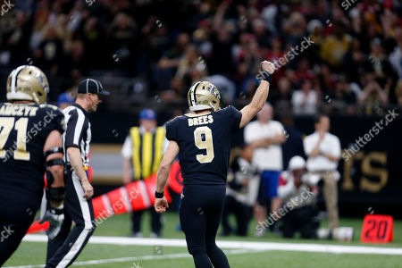 New Orleans Saints quarterback Drew Brees (9) reacts in the first half an NFL football game against the San Francisco 49ers in New Orleans
