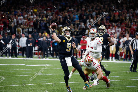 New Orleans Saints quarterback Drew Brees (9) passes under pressure from San Francisco 49ers defensive end Nick Bosa (97) in the first half an NFL football game in New Orleans