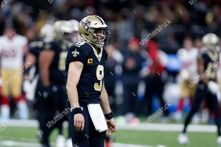 New Orleans Saints quarterback Drew Brees (9) walks off the field in the first half an NFL football game against the San Francisco 49ers in New Orleans