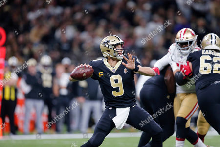 New Orleans Saints quarterback Drew Brees (9) passes in the first half an NFL football game against the San Francisco 49ers in New Orleans