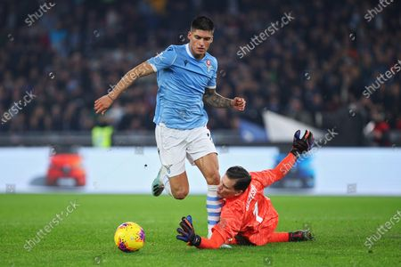Stock Photo of Joaquin Correa of Lazio falls in front of Juventus goalkeeper Wojciech Szczesny who makes a fault in the penalty area during the Italian championship Serie A football match between SS Lazio and Juventus on at Stadio Olimpico in Rome, Italy - Photo Federico Proietti/ESPA-Images