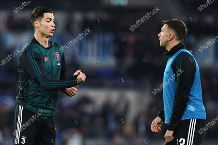 Cristiano Ronaldo (L) and Federico Bernardeschi (R) of Juventus talk to each other during the warm up before the Italian championship Serie A football match between SS Lazio and Juventus on at Stadio Olimpico in Rome, Italy - Photo Federico Proietti/ESPA-Images