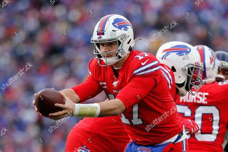 Buffalo Bills quarterback Josh Allen (17) hands off to Devin Singletary during the second half of an NFL football game against the Baltimore Ravens in Orchard Park, N.Y
