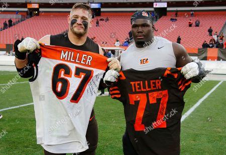 Stock Photo of Cleveland Browns guard Wyatt Teller, left, and Cincinnati Bengals offensive guard John Miller swap jersey's after an NFL football game, in Cleveland. The Browns won 27-19