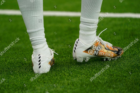 Denver Broncos wide receiver Diontae Spencer wears special cleats prior to an NFL football game between the Houston Texans and the Denver Broncos, in Houston